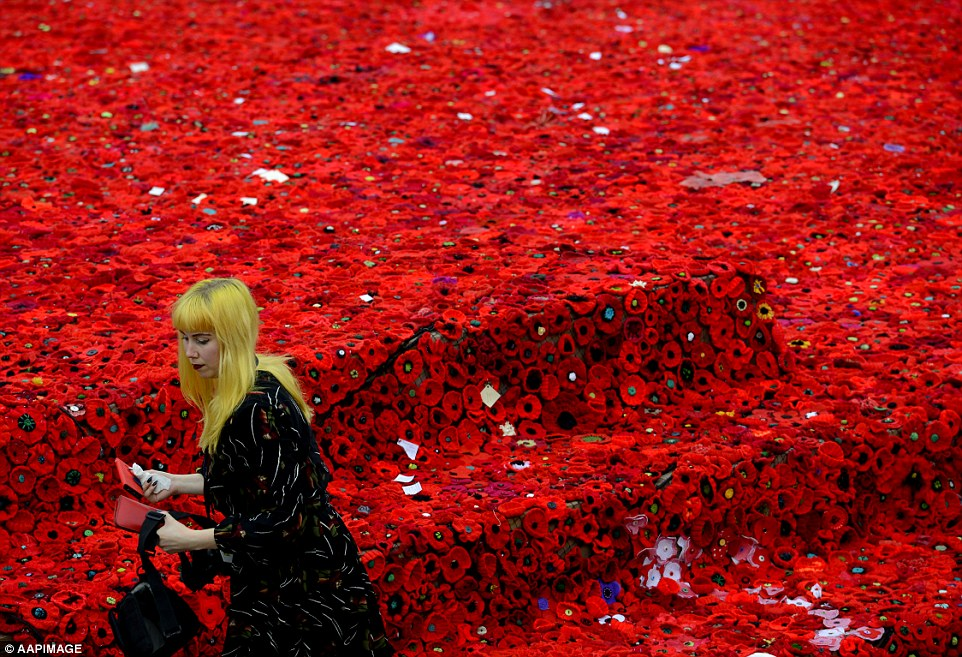 A woman visits the sea of poppies in Melbourne.Ceremonies are held annually across the country on the April 25 anniversary of the ill-fated 1915 landing of the Australian and New Zealand Army Corps at Gallipoli in modern-day Turkey during World War I
