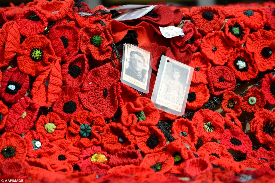 Pictures of World War One soldiers adorn a sea of poppies that blankets Federation Square as part of the 5000 Poppies project in Melbourne