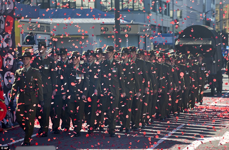 Soldiers from the Wellington Company 5/7 Battalion march through a sea of poppies during a street parade for ANZAC Day in New Zealand