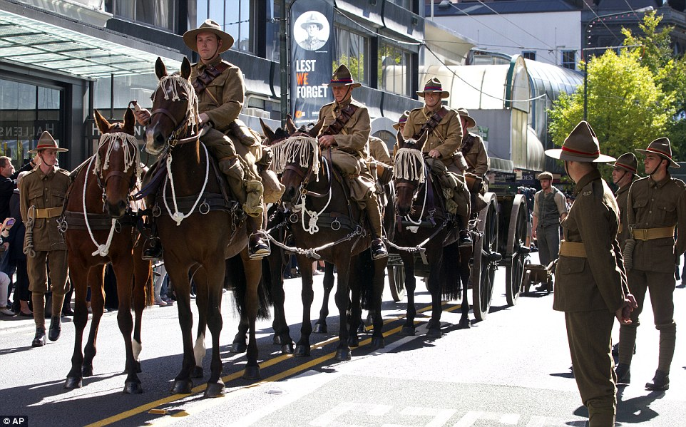 Mounted soldiers tow a gun carriage along Lambton Quay during a street parade to commemorate ANZAC Day in Wellington, New Zealand