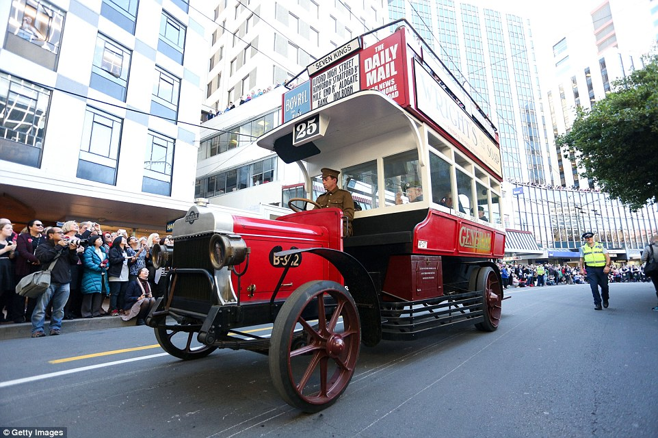 A vintage vehicle travels down Lambton Quay during the Anzac Day eve street parade  in Wellington to honour the Gallipoli landings