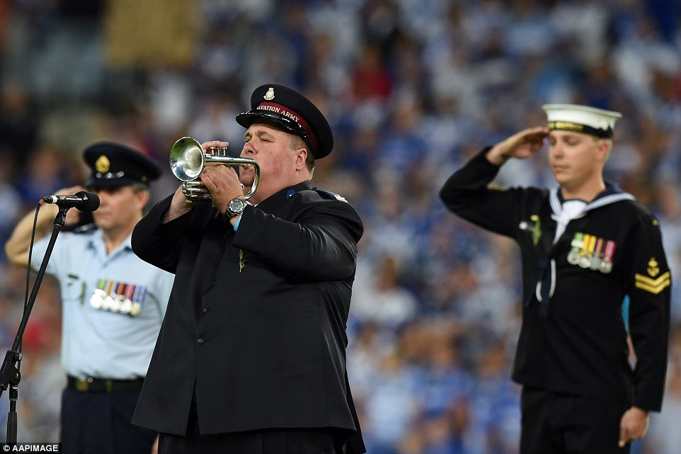 The Last Post is played to commemorate ANZAC Day before a national rugby league match between the Canterbury-Bankstown Bulldogs and the West Tigers at ANZ Stadium in Sydney