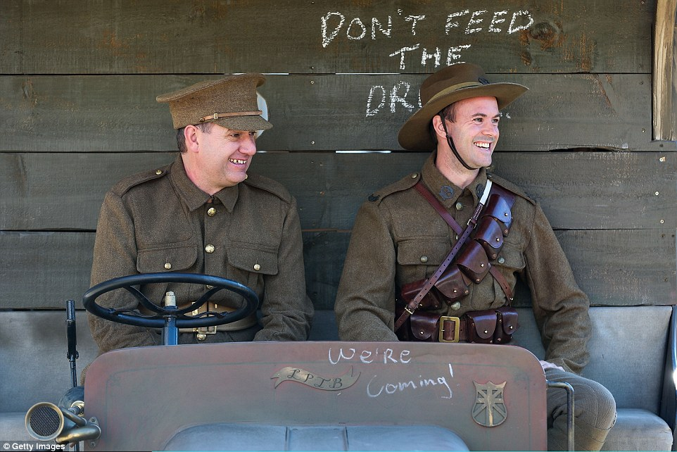 Soldiers in WW1 replica uniforms look on from the front seat of a truck during the Anzac Day eve street parade  in Wellington, New Zealand