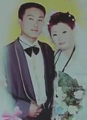 Jiang says she can't understand why she hasn't heard from her husband - pictured with her on their wedding day a decade ago