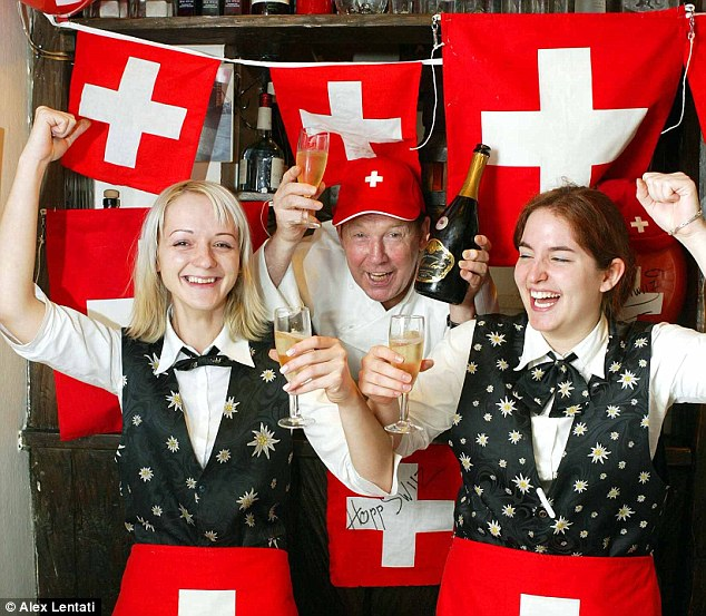 Celebration: Switzerland is the world's happiest nation thanks to healthy GDP figures, strong social bonds and an increasing life expectancy, a new study of global wellbeing has revealed