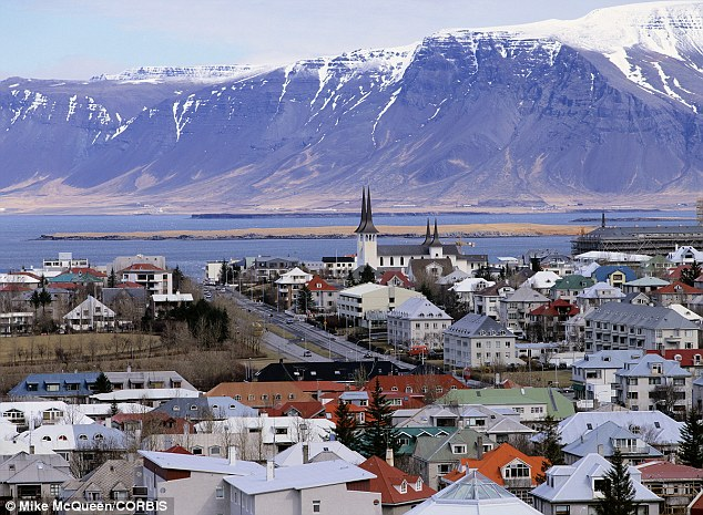 Spectacular: Icelandic citizens are now so happy that the country jumped from number nine in 2013 to number two this year, thanks in part to their well beautiful scenery (pictured) and cultural history
