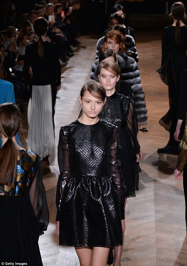 Major changes: Models can be seen strutting down the catwalk during the YDE show at Paris Fashion Week in March. Agencies who employ 'too-thin' models face large fines and even jail time under the new French law