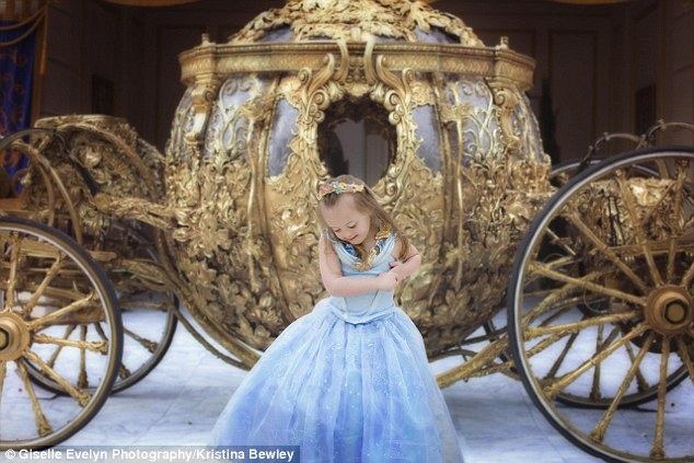 Dream come true: Giselle looks every bit a princess in this Cinderella dress her mother bought for her