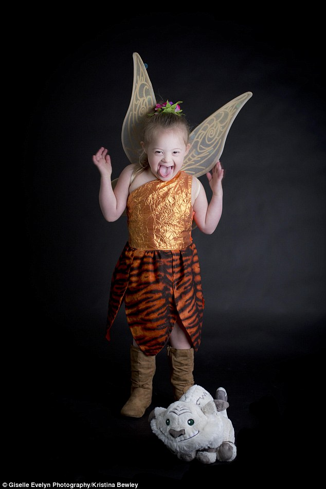 Spreading her wings: Dressing up in costumes and visiting the park has given Giselle more confidence