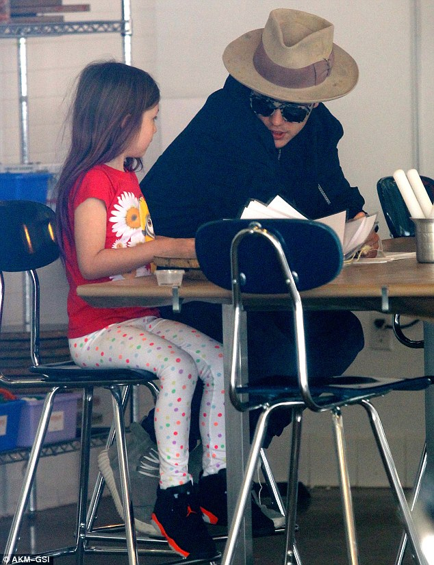 I;m a cool bro, right?: Bieber tried to look suave with his sunglasses on as he talked to the little one