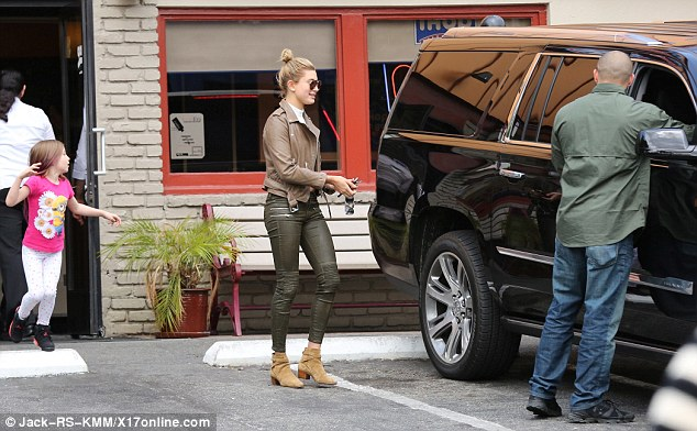 I call Shotgun! Hailey, who hails from Arizona, talked to a bodyguard as she left the old-fashioned dining establishment