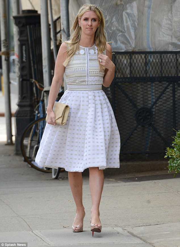 Dressed to impress: Nicky Hilton looked gorgeous in a white patterned dress as she was pictured in East Village, NYC, on her way to theNew York Presbyterian Hospital Luncheon on Thursday