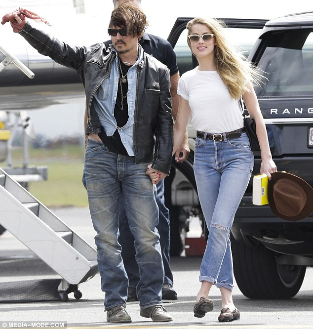 United front: The couple touched down in Brisbane on Tuesday, and were seen together in a number of weeks