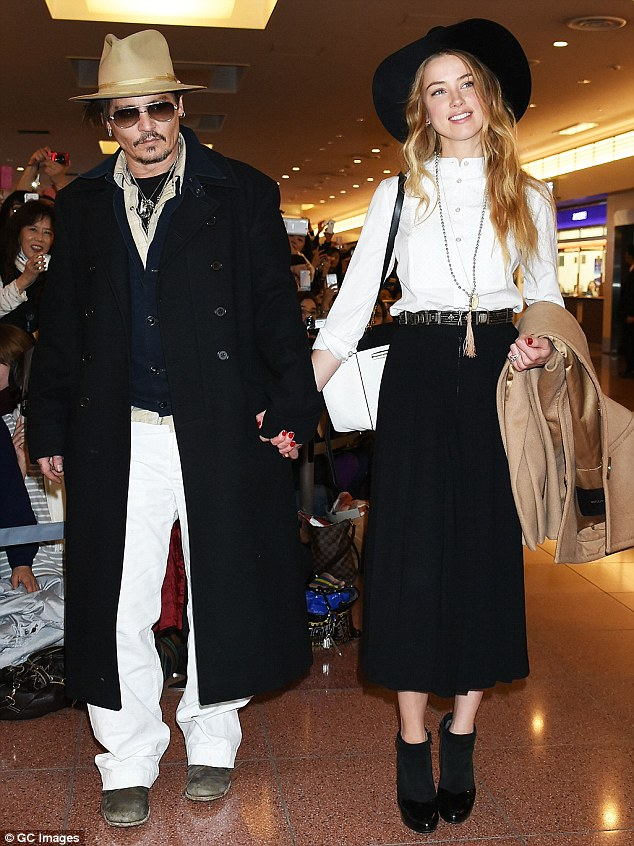 Trouble in Paradise? Reports published on Monday suggested that the celebrity couple, seen here at Haneda Airport in Tokyo on January 26, were 'leading separate lives'