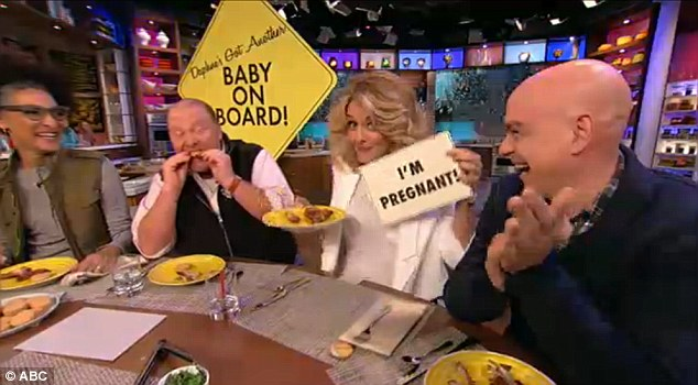 Baby on board: She started by saying, 'This may or may not be something you know about me,' before simply holding up a sign which read, 'I'm pregnant