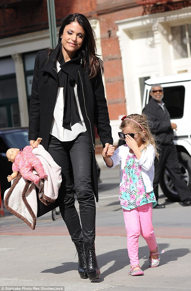 The brunette beauty, who's currently single, shares custody of daughter Bryn, seen with her in NYC last week, with her estranged husband Jason Hoppy