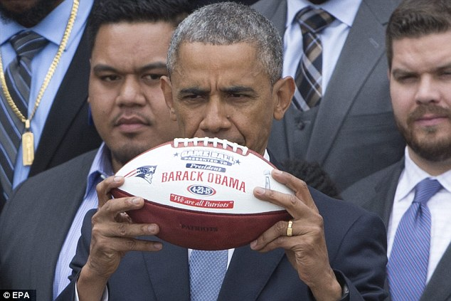 Obama received a custom jersey and a custom football from the team at the White House on Thursday