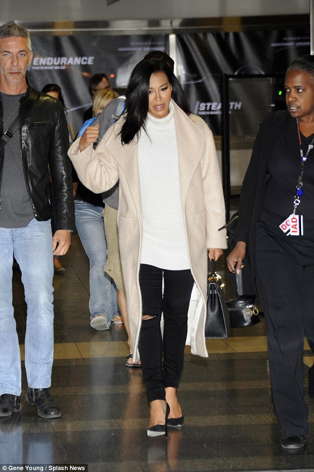 Glamorous: She showed off her slender legs in black ripped jeans - the style choice of the season