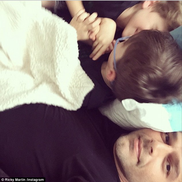 Snuggle time! Ricky and his boys took some time to relax between shows in New Zealand on Wednesday