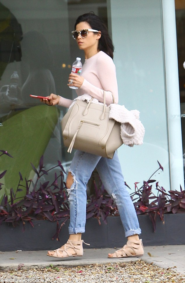 Pastel: She opted for a soft palette, with a pale pink sweater, biscuit-coloured bag and ivory cardigan which she carried