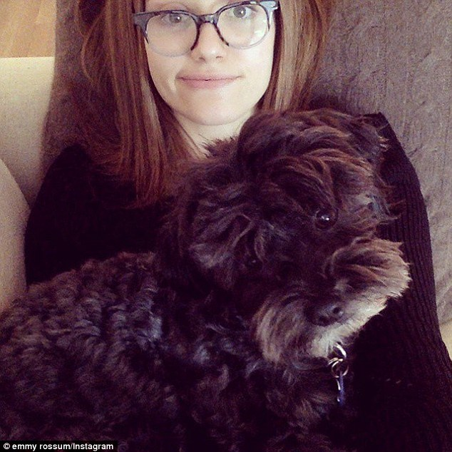 'It's hard to read with a dog on you': Emmy's reading plans were interrupted by her pet pooch Pepper