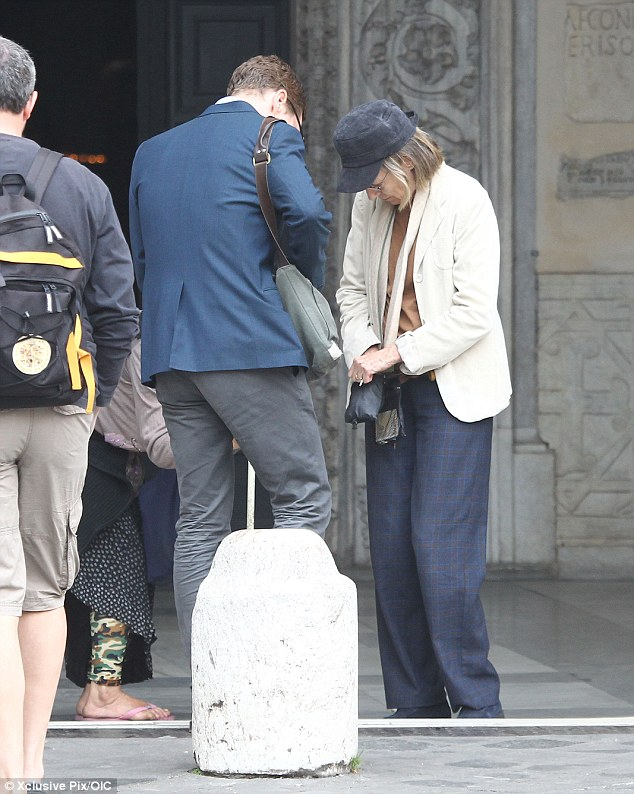 Helping hand: The actor stopped to find some change to give to an elderly lady