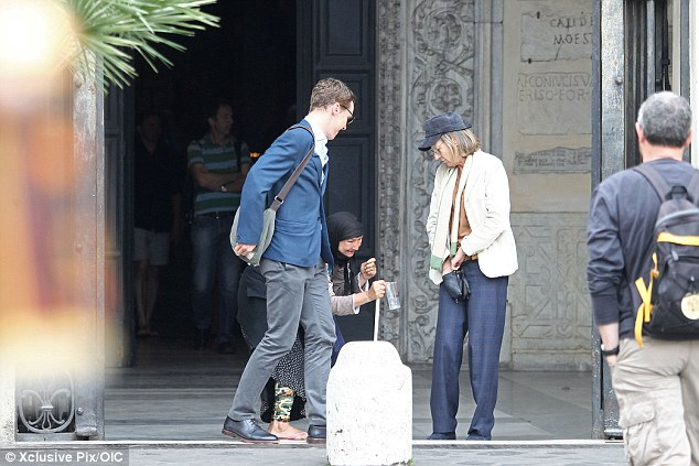 Kind hearted: The star and his friend gave the lady some money as they headed out