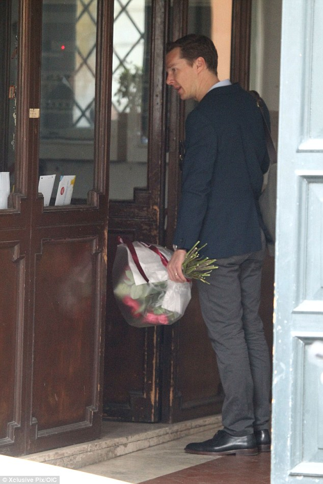What a gent: The actor was seen bringing his friend some pretty flowers