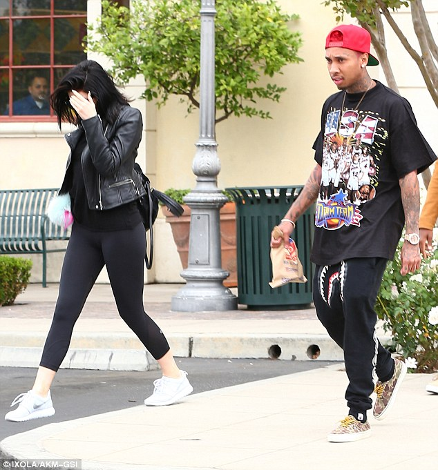 Matching in black: The 17-year-old reality star  and the 25-year-old rapper kept close during the outing