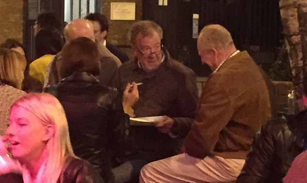 Jeremy Clarkson was seen out for a drink with friends last night, stopping at pub in west London after meeting with former Top Gear co-presenters Richard Hammond and James May, as well as producer Andy Wilman