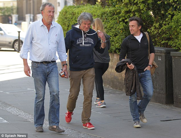 Back together: Jeremy Clarkson (left) is seen with his Top Gear colleagues James May (centre) and Richard Hammond (right) outside his  west London flat, in their first public appearance since he was sacked