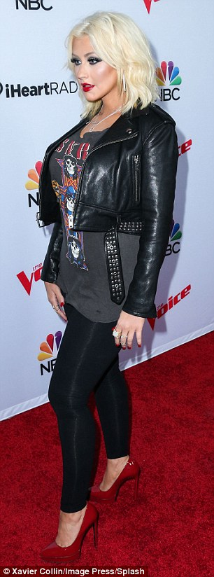 Making a lasting impression! Christina was impossible to miss with her edgy leather jacket and ruby red heels