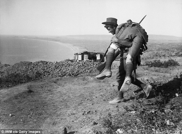 An Australian carrying his wounded mate to a medical aid post for treatment, in Gallipoli, in 1915