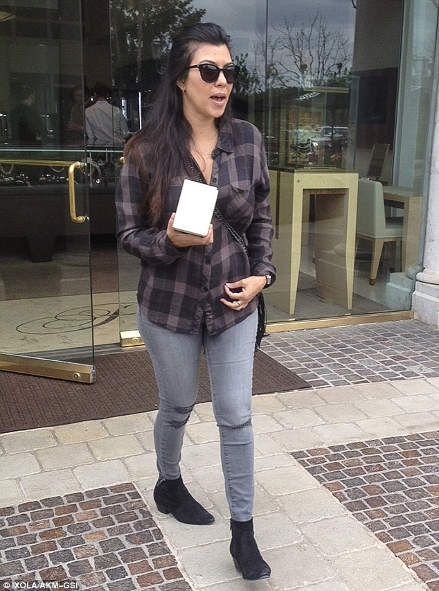 Keeping watch on the kids: Kourtney Kardashian looked like any other harried mom as she hit up Polacheck Jewelry Store in Calabasas on Thursday with her two children Penelope, two, and Mason, five