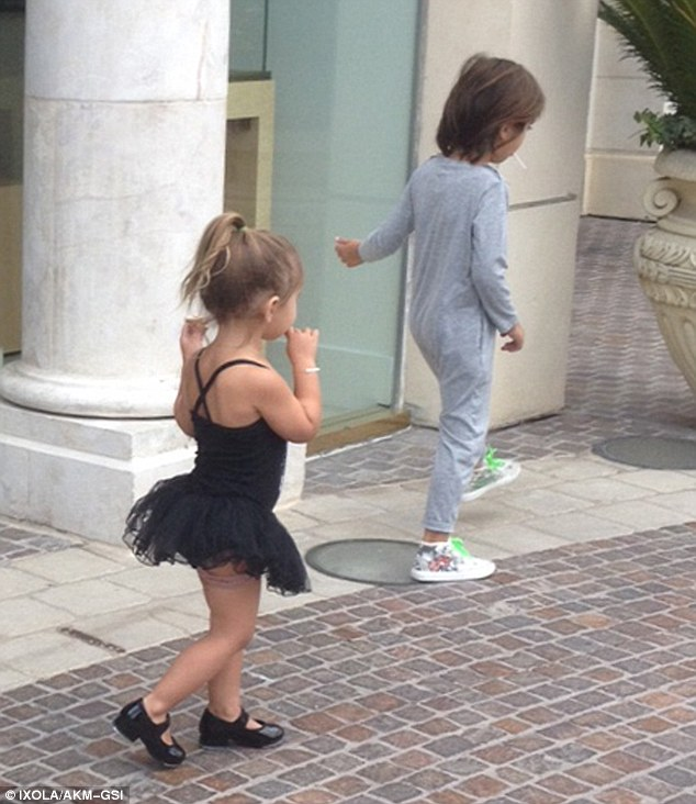 Play clothes: Penelope looked cute in a black leotard and tutu while Mason was clad in a comfy jumper