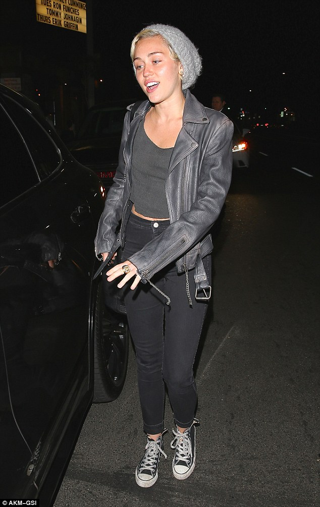 Lifting her spirits: Newly single Miley Cyrus managed a smile after a night at Improv Comedy Club in West Hollywood on Wednesday