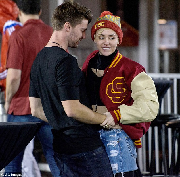 The way they were: Cyrus and her then-boyfriend Patrick Schwarzenegger were seen at a USC football game in November