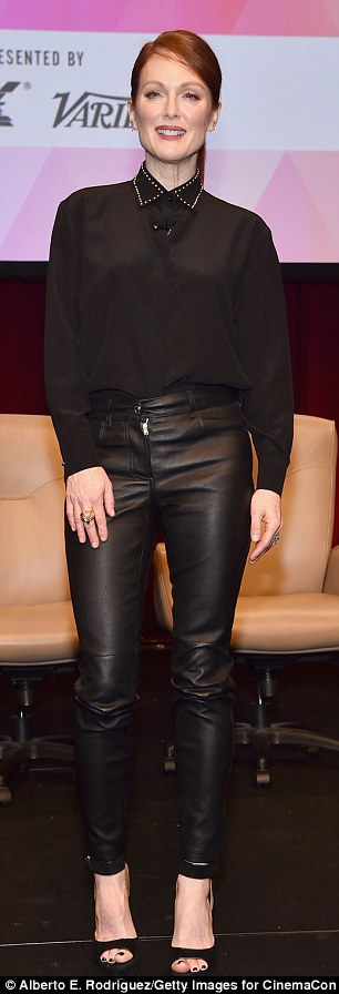 Leather mama: Earlier, the 54-year-old Oscar winner had looked fierce in a black collared blouse and leather trousers for a panel discussion