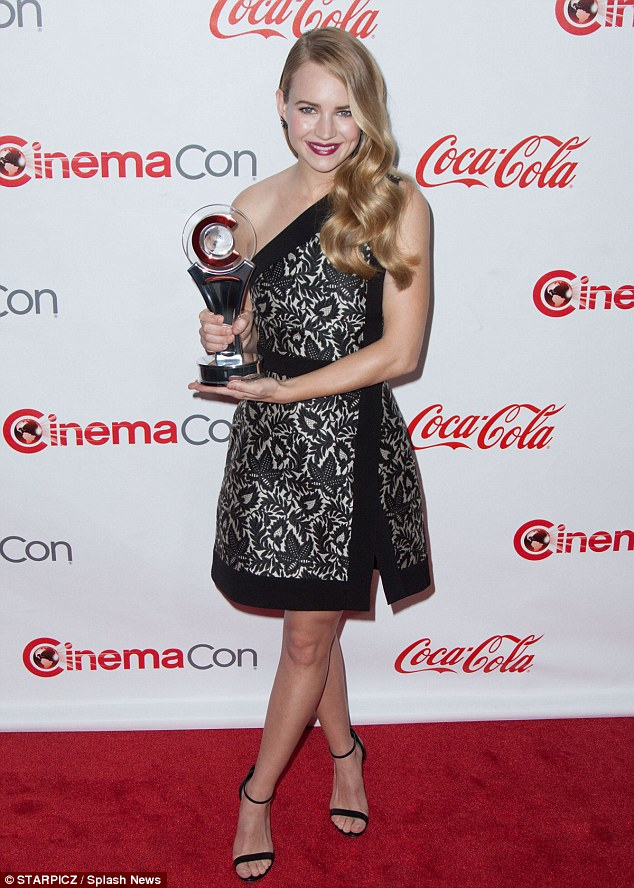 Blonde bombshell: Tomorrowland ingénue Britt Robertson - winner of the Star of Tomorrow award - looked elegant in a single-strapped cocktail dress