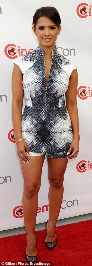 Leggy lady: The Daily Share correspondent Rocsi Diaz showcased her bronzed beauty in a pixel-patterned pencil dress and a b&w romper