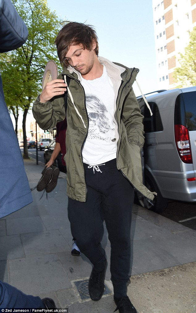 Second wear: Wearing the same trousers he sported for his boys' night out on Wednesday, the singer/songwriter looked a tad disheveled in his green coat and trainers