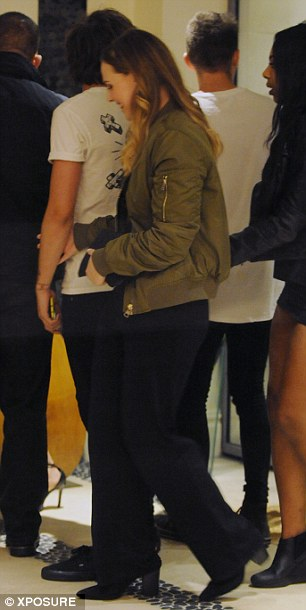 Special girl: It seems one lady was on familiar terms with the One Direction star as she held his arm