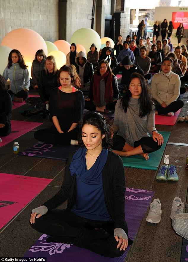 Leading the pack: She sat front and center inside the vibrant yoga studio with more than 100 yogis in attendance