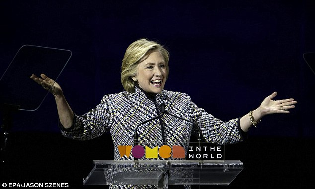 In the running:The houndstooth-suited Democratic presidential candidate received a standing ovation and spoke about being 'closer than we've ever been to achieving equal rights for women'