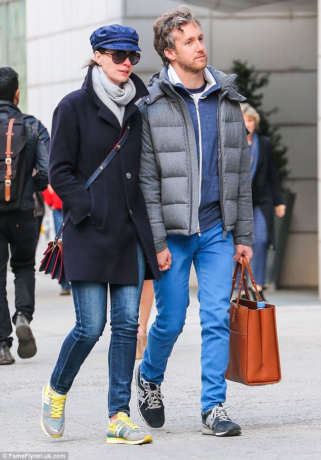 Smitten: Anne Hathaway, 32, wrapped up for a stroll with husband Adam Shulman, 34, in New York City on Thursday