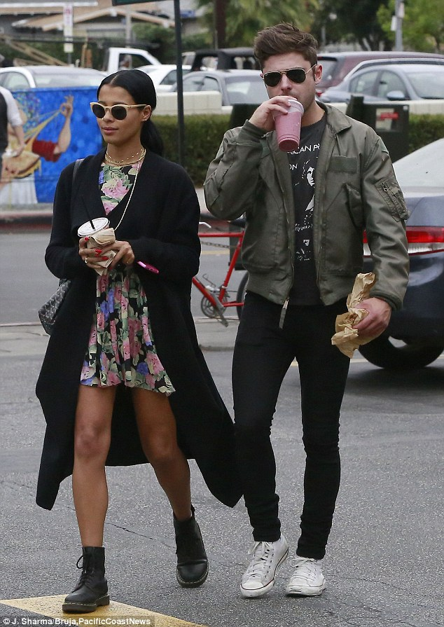 Berry healthy: Zac Efron fueled up on a berry smoothie from The Oaks Gourmet Market in LA's Los Feliz area with his girlfriend Sami Miro on Thursday