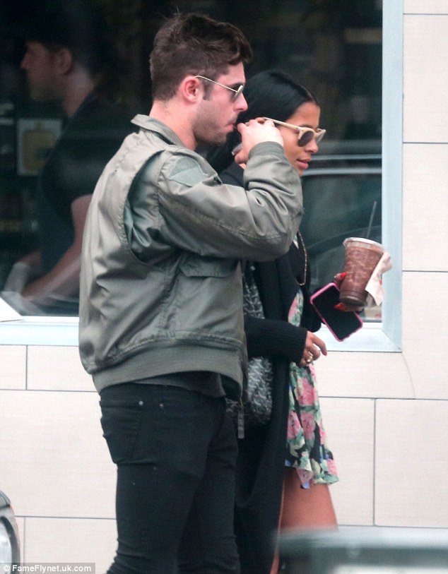 Down the hatch: The High School Musical star proceeded to gulp his beverage down as soon as he left the store alongside his lady love