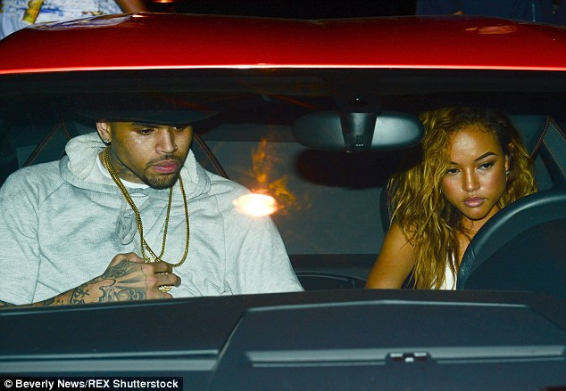 Over now: Karrueche looks downbeat as her ex Chris Brown lets her drive him home after a night out in Los Angeles last June