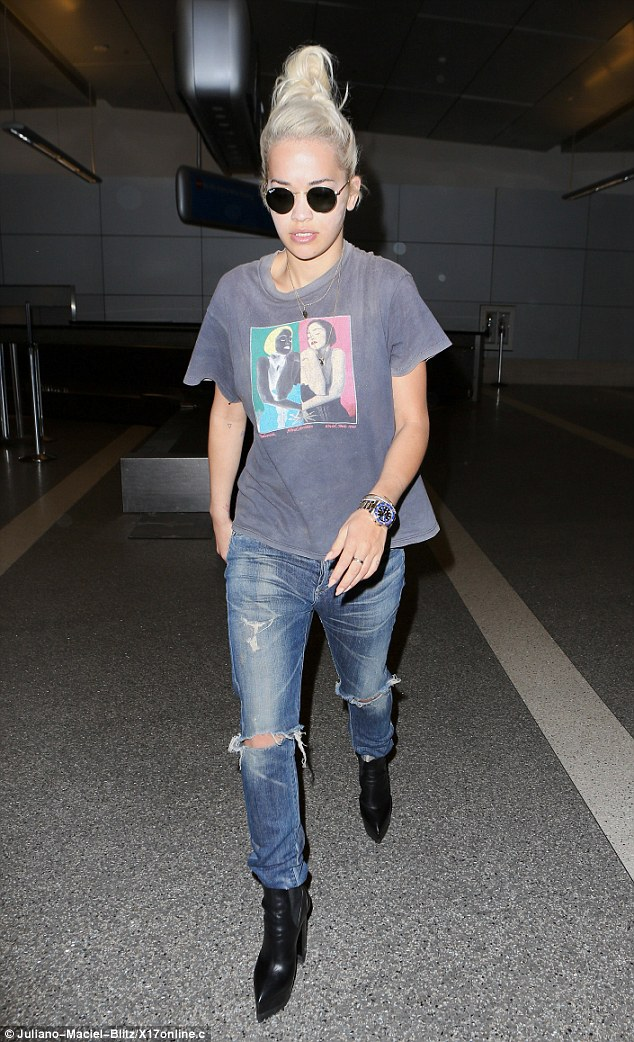 Showing support! On Thursday, Rita Ora showed her love for Madonna by wearing an original Blonde Ambition tour T-shirt as she made her way through LAX