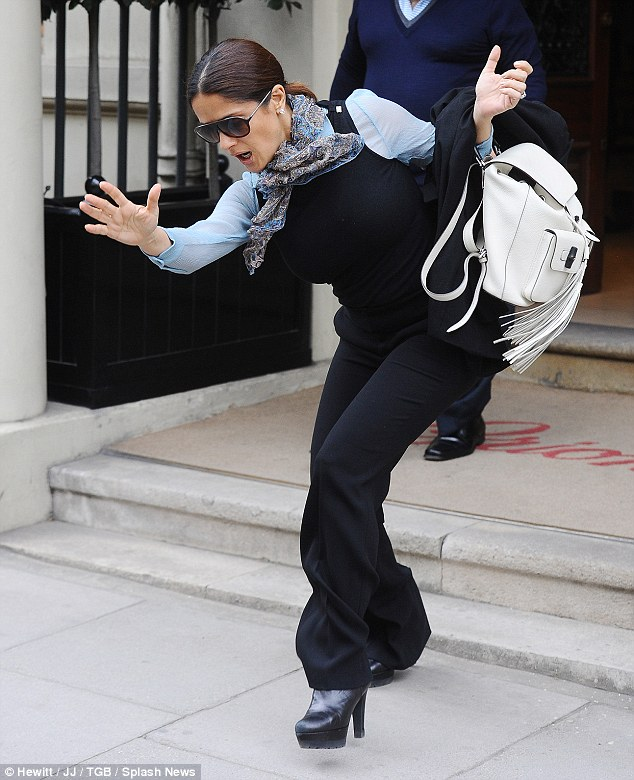 Styling it out: Salma reacts as she loses her footing and manages to regain her composure